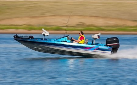 bass fisherman in a blue boat
